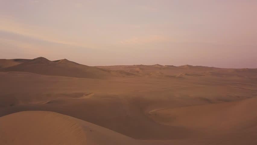 Drone Aerial of Sand Dunes Desert Oasis at Sunrise #1011340754