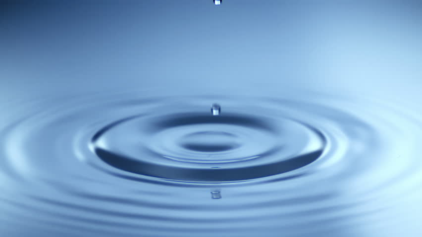 Slow Motion Water drop splash into calm water - shot with ultra high speed camera   Shutterstock HD Video #1011346571
