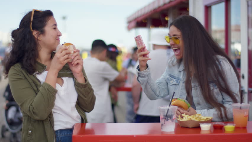 Excited Tourists Pose With Their Burgers For Fun Vacation Selfies On The Santa Monica Pier (Shot On Red Scarlet-W Dragon In 4K, Slow Motion)