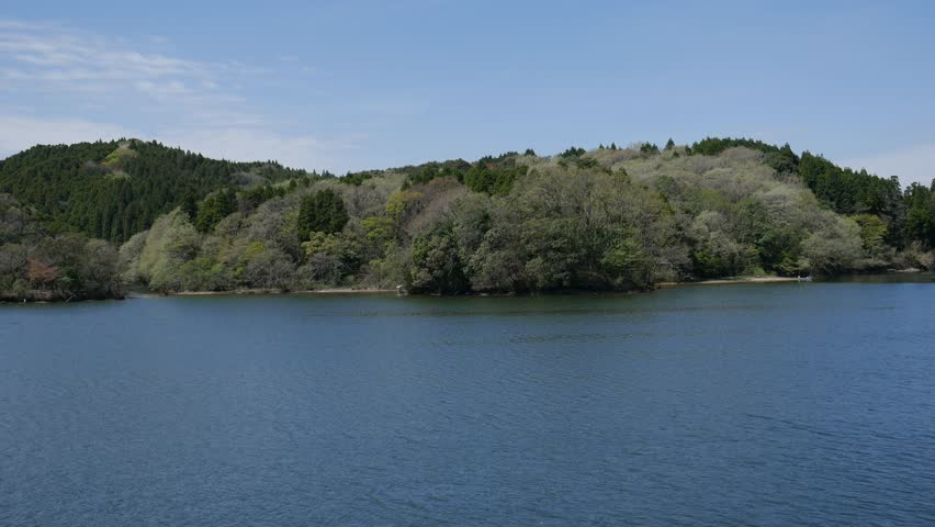 Reservoir of a straight concrete gravity dam in Saga prefecture, JAPAN. Spring time. Panning. without sounds