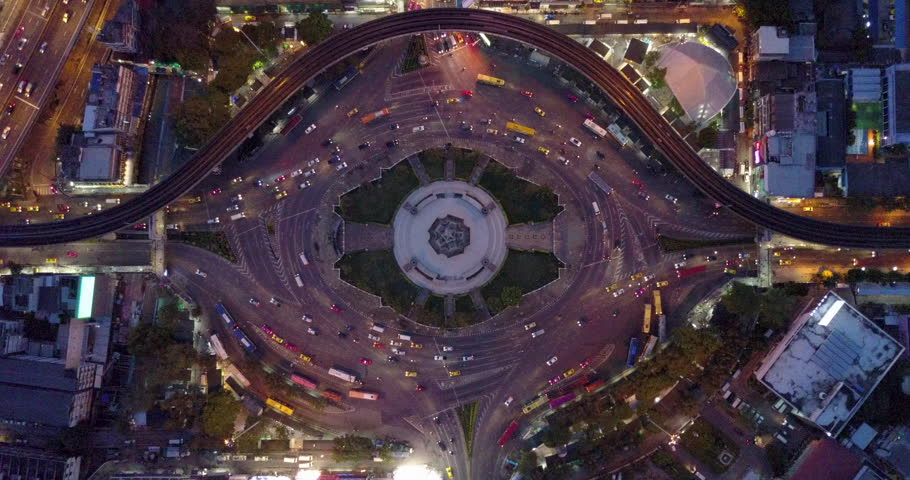4K. Aerial view of huge roundabout and traffic lights at Victory Monument during the night time. Landmark of Bangkok, Thailand