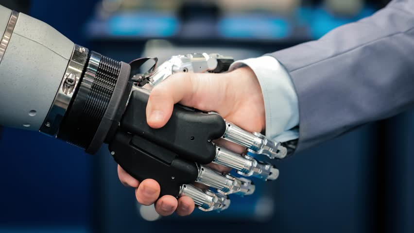 Hand of a businessman shaking hands with a Android robot. The concept of human interaction with artificial intelligence. #1011353930