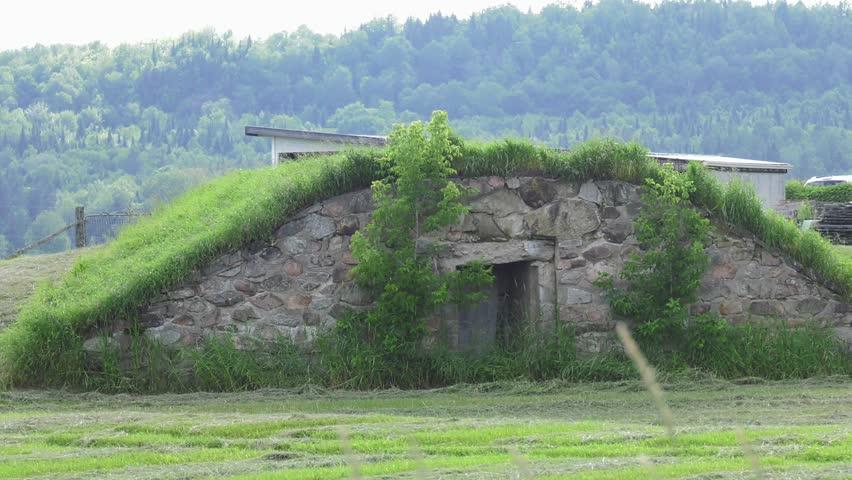 underground bunker entrance in a field 4k