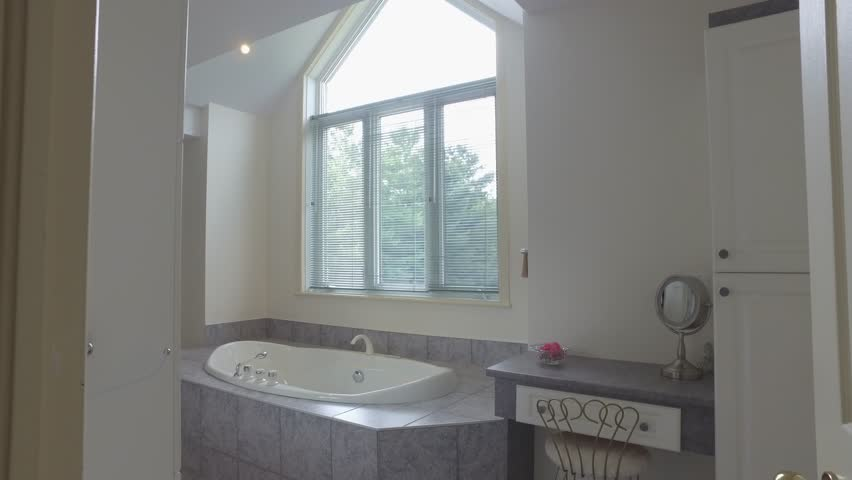 Real estate bathroom classy and bright pan entrance 4k