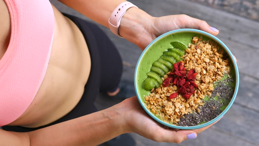 Concept Of Diet, Proper Nutrition And Health. Sport Woman Holding Smoothie Bowl #1011360785
