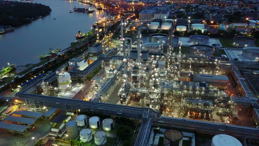 4K Night time aerial shot from oil tanks in a refinery