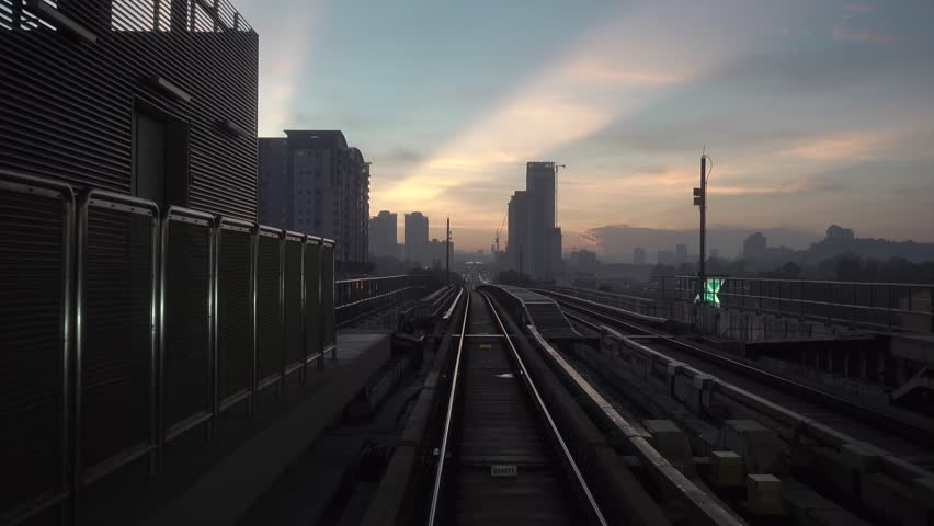 KUALA LUMPUR, MALAYSIA - 11 MAY, 2018 : Malaysia MRT (Mass Rapid Transit) train and railway during sunrise. MRT is a transportation for future generation and bring Malaysia as a developed country | Shutterstock HD Video #1011376526