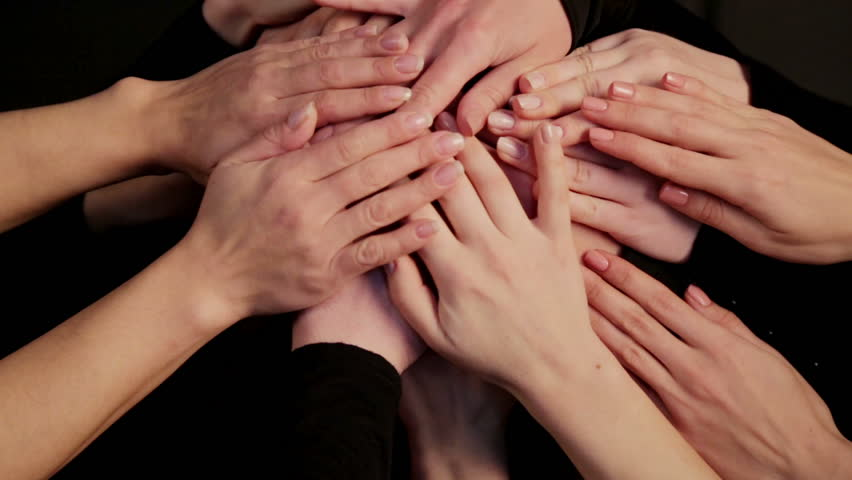 The face of the girl close up is closed by a multitude of hands. Portrait of a womans face hidden in a multitude of hands.    Shutterstock HD Video #1011414056