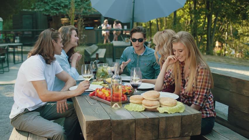 Happy Friends In Outdoor Picnic Party Having Fun   Shutterstock HD Video #1011440564