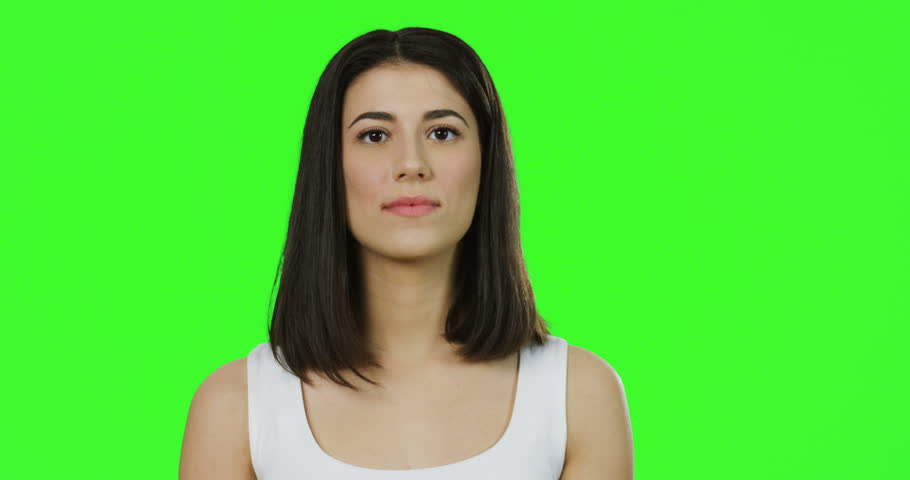 Close up of the young brunette woman in the white shirt waving hands as it is hot on the chroma key background. Green screen | Shutterstock HD Video #1011449510