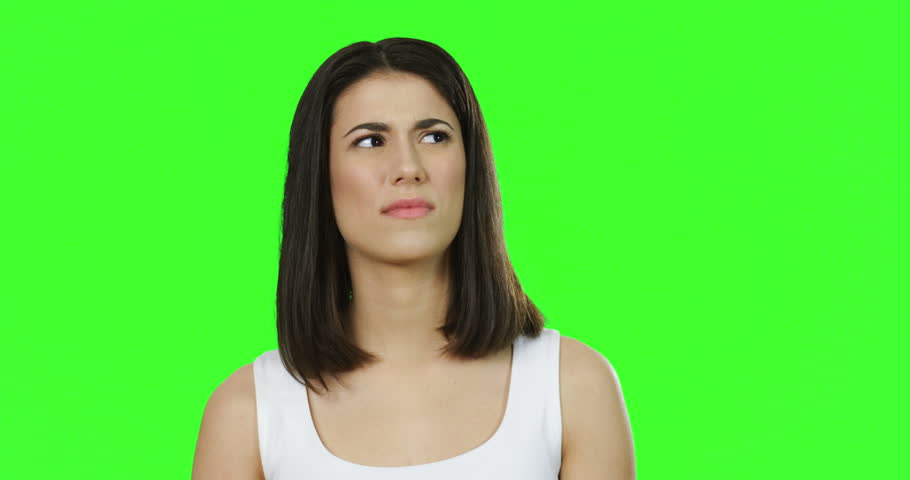 Young pretty brunette woman closing her nose with fingers and feeling bad smell on the green screen. Chroma key | Shutterstock HD Video #1011449534