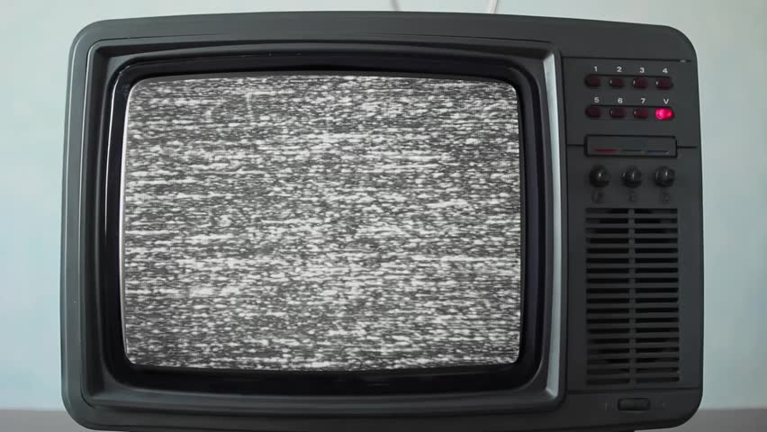 No signal just noise on a small TV in a room | Shutterstock HD Video #1011465278