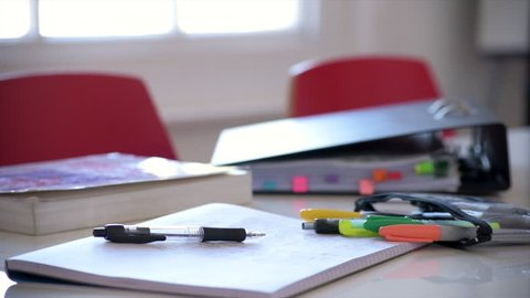 Panning mid shot of revision stationery and equipment