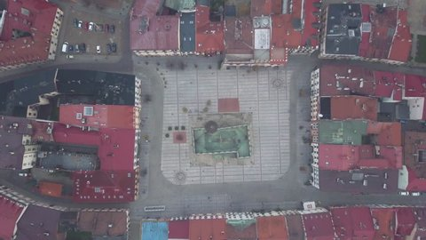 Tarnow Poland Town Square - 4k Birds Eye View Drone Shot During Foggy Overcast Morning in the City. Church in Symmetric Square Surrounded by Red Roofs