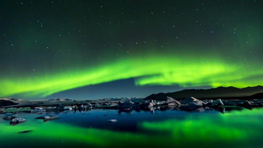 Timelapse Aurora Boreal Northern lights by jokulsarlon glacier, is one of the most impressive nature phenomena of the world, it is incredible to be able to see it in the middle of the night. | Shutterstock HD Video #1011484604