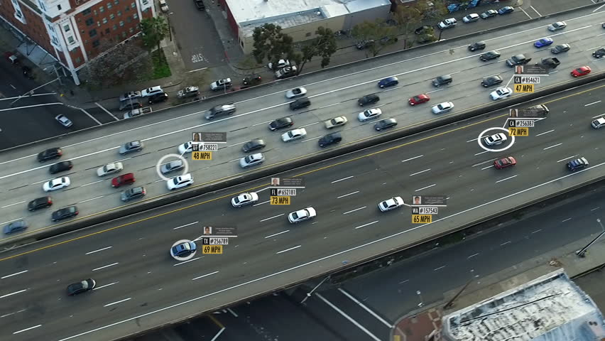 Highway aerial view with fake car speed, plate number, driver information and ID. Perfect to illustrate concepts as: surveillance, big data, traffic control, futuristic cities. Future transportation.  #1011485609