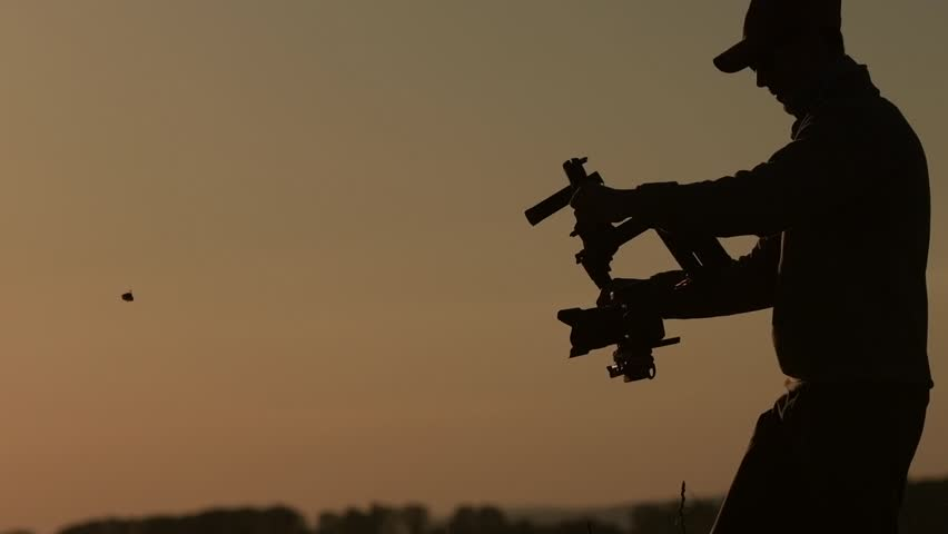 Digital Video Camera Gimbal Stabilization. DSLR Videography Equipment. Slow Motion Video