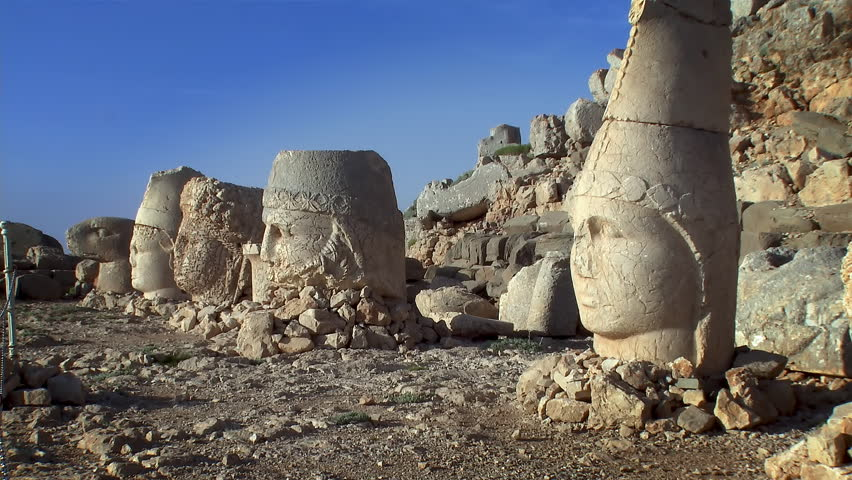 Mount Nemrut or Nemrud, Adiyaman Province, Turkey : pan across the fallen ancient statue heads from the Tomb of Commagene King Antochus 1