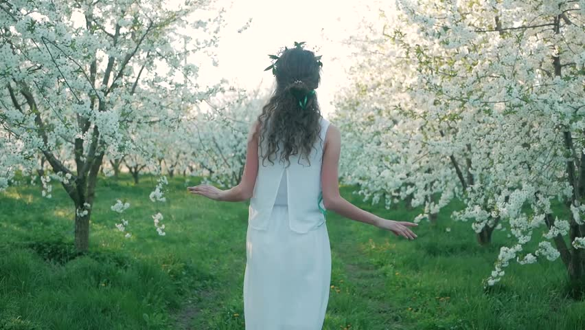 Girl walking on a blooming garden and resting
