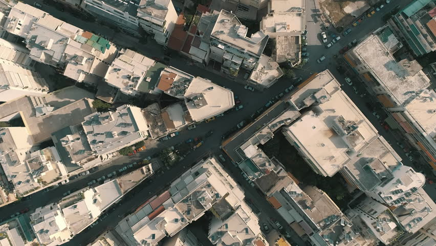 Athens aerial,downtown buildings,apartments vertical view.Tight and overly populated concrete building blocks and typical downtown neighbourhoods, streets, and traffic near the center of Athens,Greece