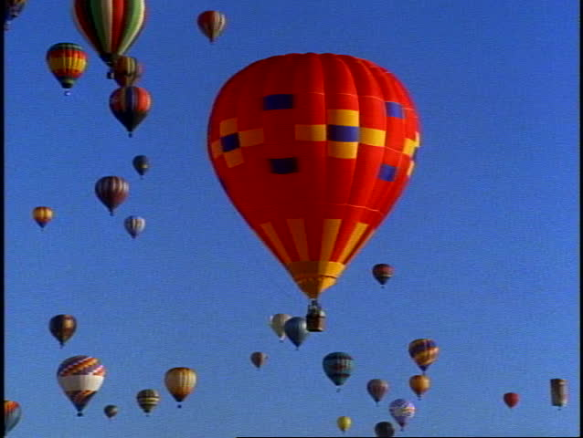 ALBUQUERQUE, 1999, Albuquerque Hot Air Balloons in Air, many surrounding one balloon   Shutterstock HD Video #1011531458