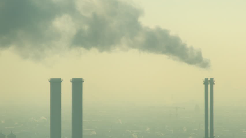 4K video pollution from industrial factory chimneys on the skyline of Berlin, Germany