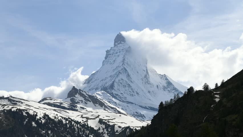 4k video Time lapse  very beautiful nature of  Matterhorn mountain , Switzerland Alps view from Zermatt , Moving cloud  #1011559565