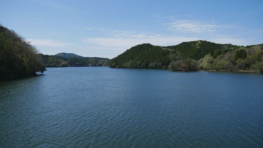 Reservoir of a straight concrete gravity dam in Saga prefecture, JAPAN. Spring time. without sounds