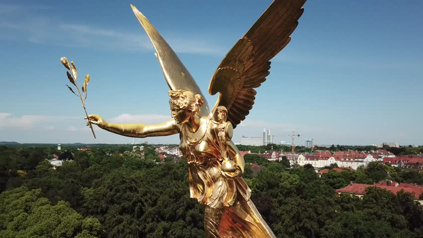 The Friedensengel is a sculpture on the Isarhochufer in Munich Bogenhausen at a height of about 34m, circling drone view, close-up, summer