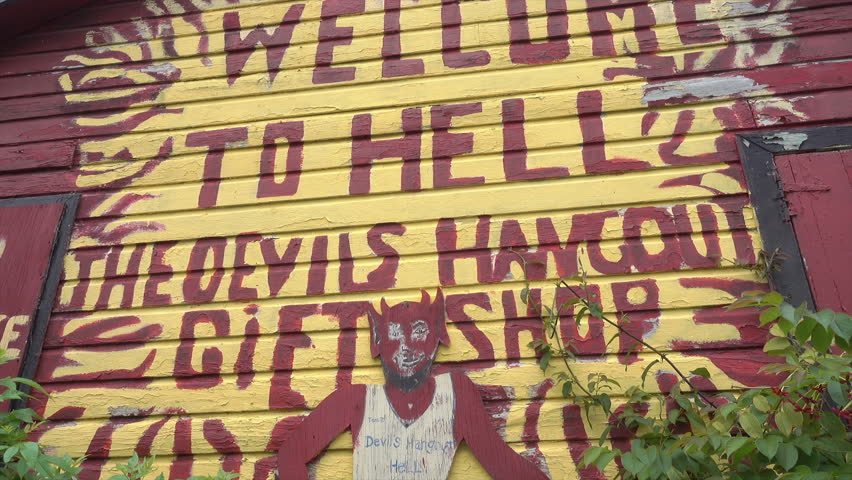 HELL, GRAND CAYMAN/CAYMAN ISLANDS - JANUARY 20, 2018: Welcome to Hell sign on gift shop, Grand Cayman Islands, Caribbean. Hell refers to an open space filled with clusters of short black limestone.   Shutterstock HD Video #1011610427