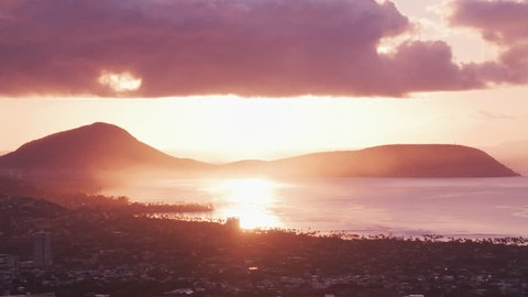 Honolulu, Oahu, Hawaii circa-2018, Aerial view of Maunalua Bay with Koko Crater in distance at sunset. Shot with Cineflex and RED Epic-W Helium.