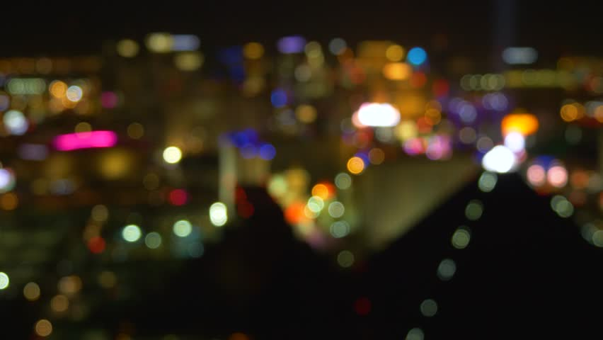 Out Of Focus Vegas Strip Casino Lights Wide View. Las Vegas strip at night. Blur background Las Vegas Nevada strip at night. Blurred city lights of Las Vegas Boulevard. | Shutterstock HD Video #1011680261