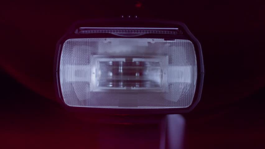 Camera Flash Close Up   Shutterstock HD Video #1011682619