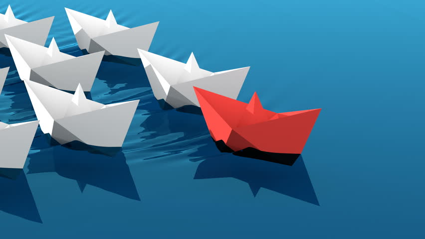 Leadership concept, red leader boat with white paper boats floating in the blue waves of the sea