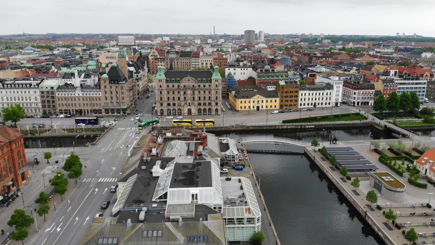 Aerial view of cityscape of Malmo, capital city of Scania, city canals, mixture of historic and modern architecture - landscape of Sweden from above, Scandinavia, Europe, 4k UHD   Shutterstock HD Video #1011704468