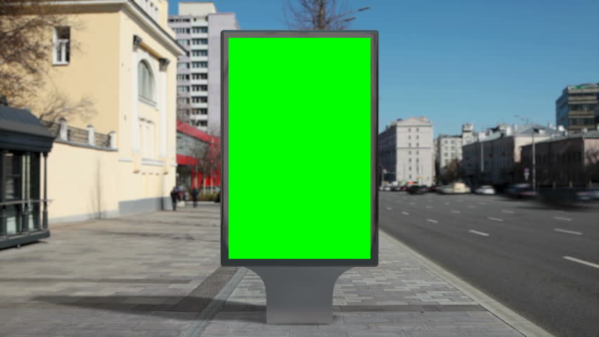 Street billboard stand with green screen on time lapse city background. Seamless loop.