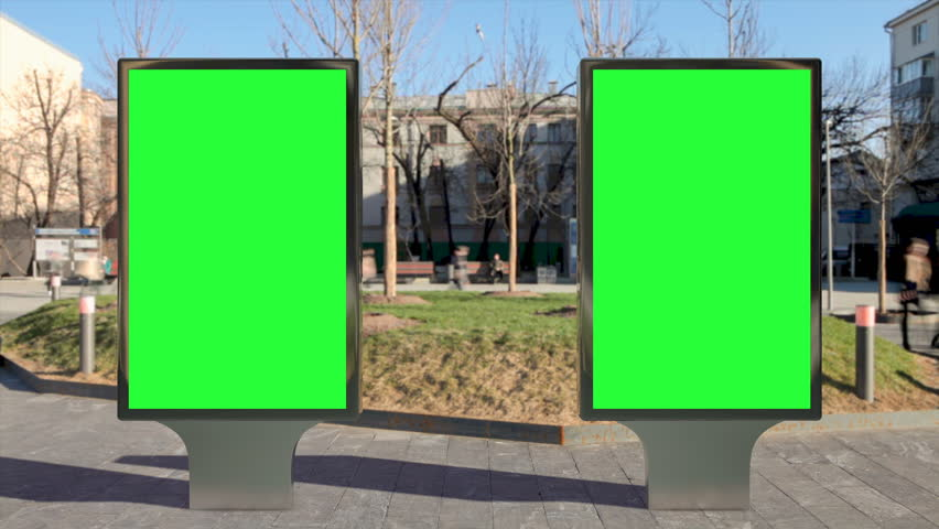 Two street billboard stands with green screen on pavement. Time lapse seamless loop. | Shutterstock HD Video #1011711650