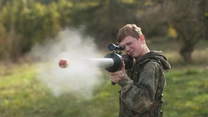 Boy shooting a potato gun in super slow motion, shot with Phantom Flex 4K