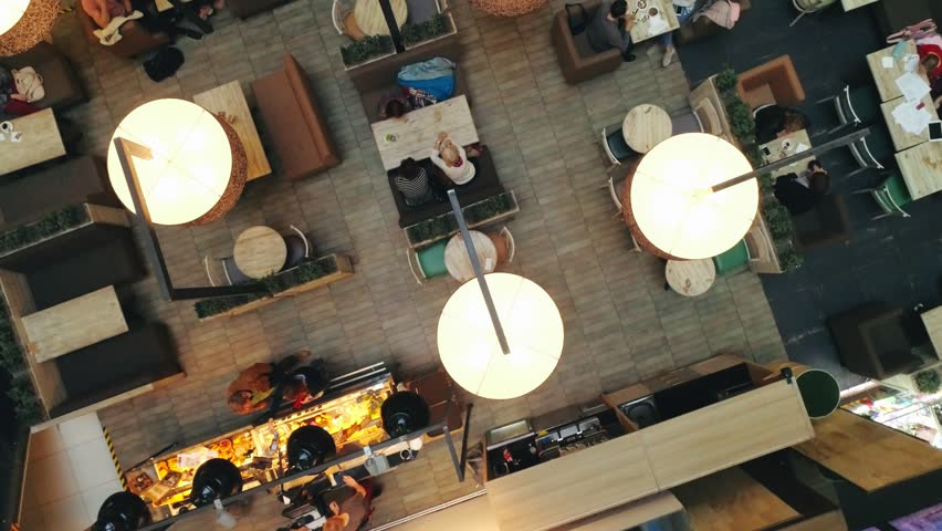 Cozy cafe in modern shopping center for snacking and resting visitors top view Royalty-Free Stock Footage #1011749285