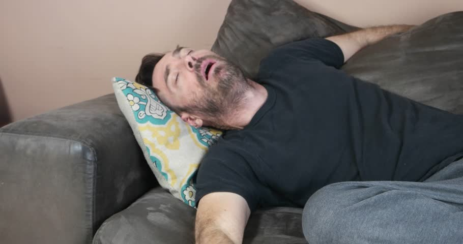 Sleeping guy falling from couch | Shutterstock HD Video #1011753254