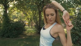 Outdoor slow motion portrait montage of a sporty woman stretching, warming up, running and posing for camera.