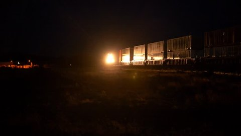Flagstaff, AZ, USA - 5/31/2018 - Freight trains passing each other at night