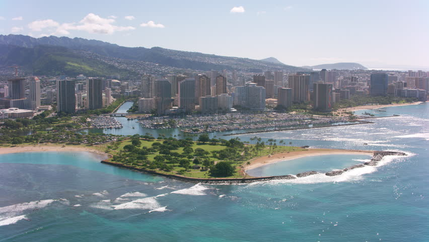 Honolulu, Oahu, Hawaii circa-2018. Flying over Magic Island and Waikiki. Shot with Cineflex and RED Epic-W Helium.