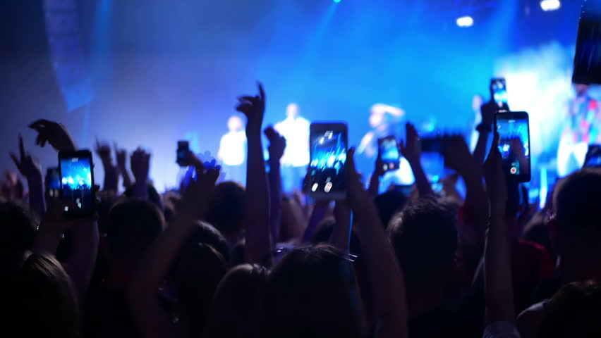 Concert live streaming mobile phone hand #1011770858