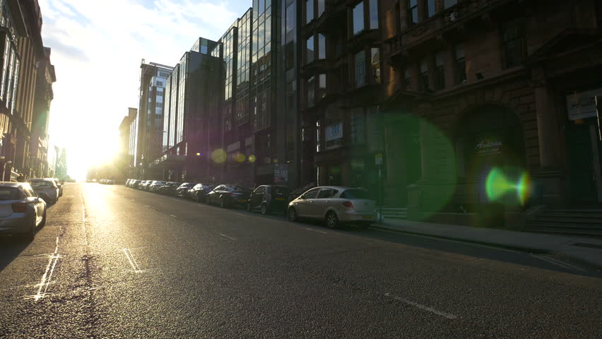 Glasgow, United Kingdom - May, 2016: Sunlight on a street with parked cars | Shutterstock HD Video #1011775331