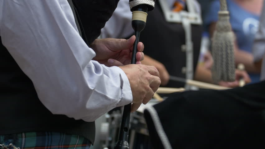 Glasgow, United Kingdom - May, 2016: Hands playing the chanter of a bagpipe #1011777086