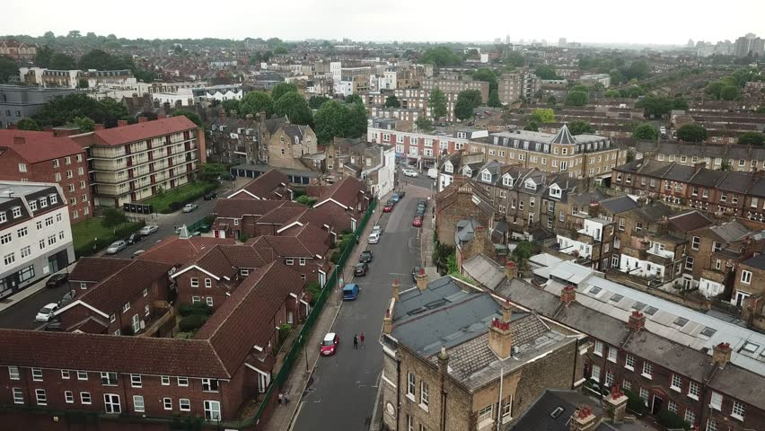 Low altitude drone flight over South West London Rooftops in England, May 2018.