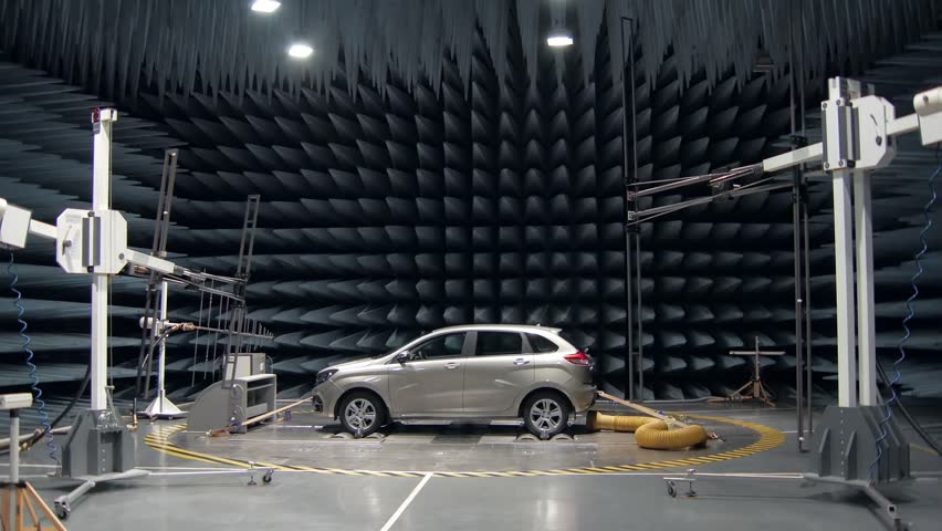 new automobile is standing in anechoic chamber for testing on a car plant, transmitters Royalty-Free Stock Footage #1011796643