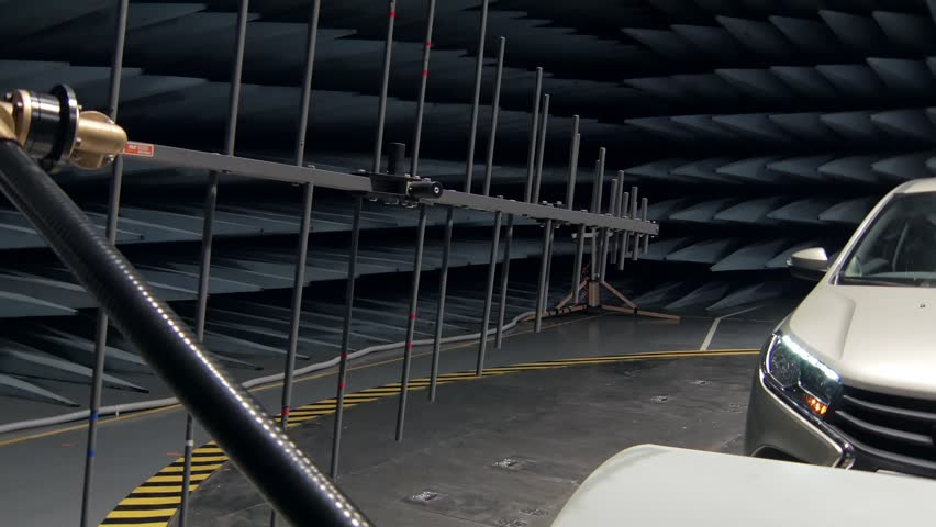 transmitter is emitting waves on working automobile in anechoic test chamber Royalty-Free Stock Footage #1011796658