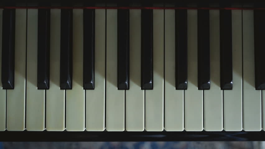 A girl practicing a scale on the piano.